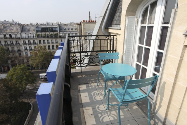 little palace hotel balcony top blue garden chairs