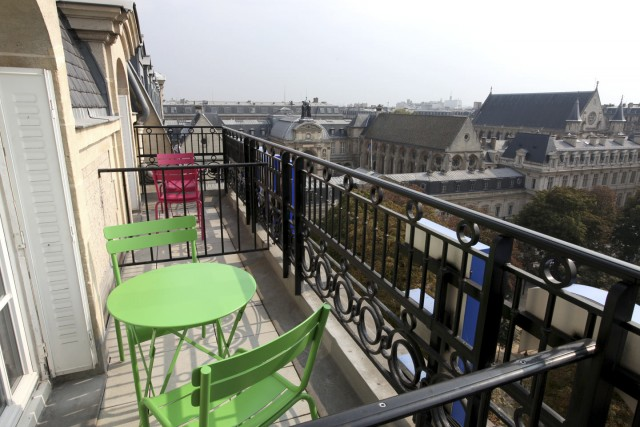 little palace hotel balcony top green pink garden chairs