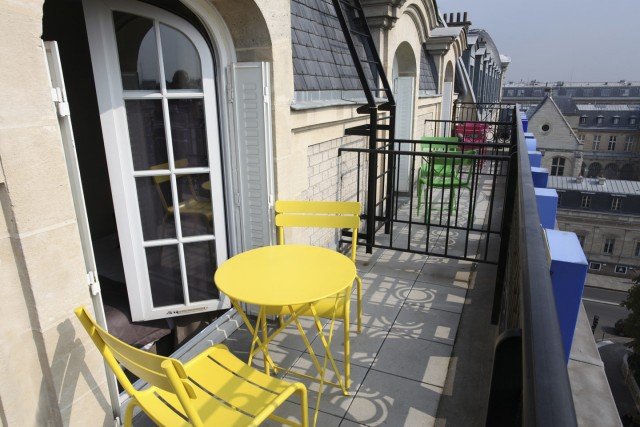 little palace hotel balcony top yellow garden chairs